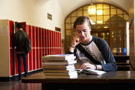 Male student reading at desk - FOLF08721