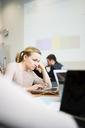 Woman using laptop in office - FOLF08943