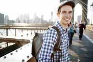 Portrait of smiling man standing on Brooklyn Bridge - CAVF34066