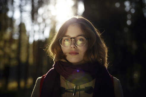 Portrait of woman in eyeglasses at forest - CAVF34259