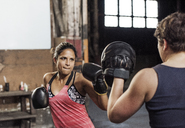 Determined female boxers practicing in health club - CAVF34427