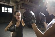 Confident female boxers practicing in health club - CAVF34433