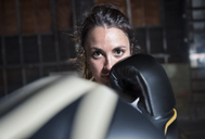 Portrait of confident female boxer in gym - CAVF34439