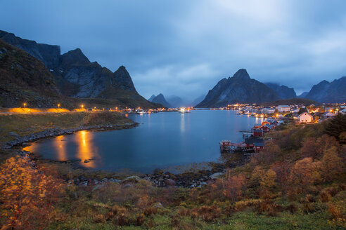 Norway, Lofoten Islands, coastal village at dusk - WVF00961