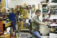 Mature volunteers working at workshop - MASF00073