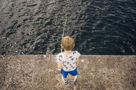 High angle view of boy standing on pier fishing in sea - MASF00133