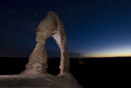 Majestic view of Delicate Arch against star field at Arches National Park during night - CAVF35019