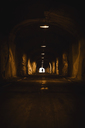 Norway, Lofoten Islands, Maervoll, silhouette of man in tunnel - WVF00965