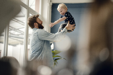 Father and baby son having fun together at home - KNSF03714