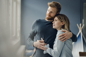 Happy couple embracing at home - KNSF03753