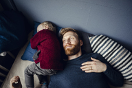 Father spending time with his son at home - KNSF03756
