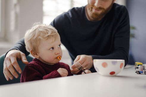 Father feeding his little son with pasta - KNSF03768