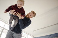 Father and baby son having fun together at home - KNSF03777