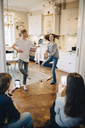 Friends photographing teenage boy and girl dancing at home - MASF00779