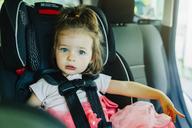 Portrait of cute girl sitting in car - CAVF35260