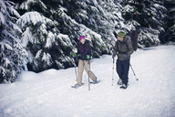 Couple snowshoeing in forest - CAVF35293