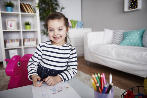 Portrait of little girl drawing in the living room - ABIF00267