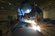 Welder at work in factory - LYF00805