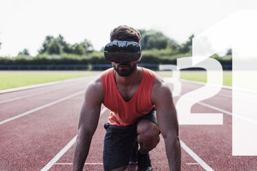 Athlete in starting position on tartan track wearing VR glasses surrounded by numbers - UUF13258
