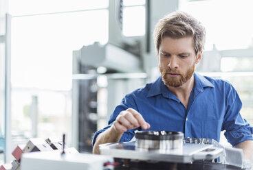 Man examining product in company - DIGF03782