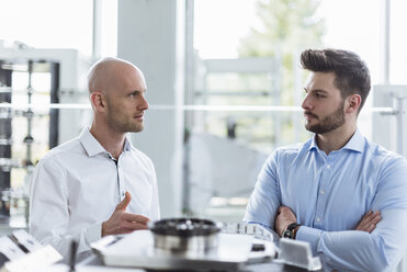 Two men discussing product in company - DIGF03785