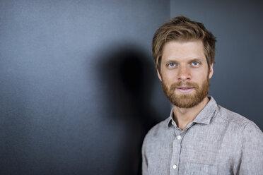 Portrait of smiling bearded businessman - DIGF03806