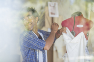 Tailor working on dress in studio - ZEF15315