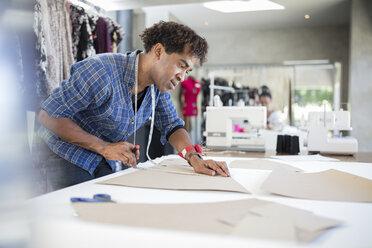 Fashion designer working on draft in studio - ZEF15324