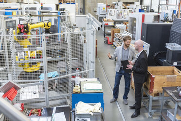 Two businessmen discussing in modern factory - DIGF03831