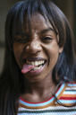 Portrait of laughing young woman sticking out tongue - EBSF02302