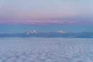 Flight above the clouds with mountains in background - AFVF00392