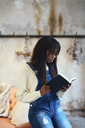 Young woman reading book at home - EBSF02321