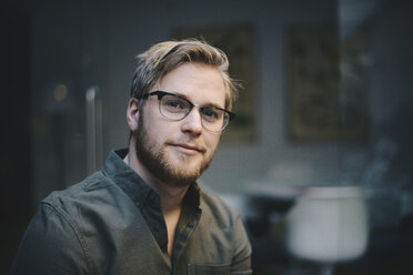 Portrait of confident male computer programmer in office - MASF01473