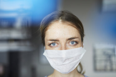 Portrait of woman wearing surgical mask - PNEF00594