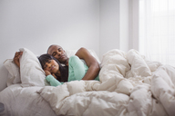 Couple sleeping in bed at home - CAVF35525