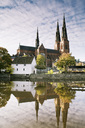 Uppsala Cathedral reflecting in River Fyris against sky - MASF01952