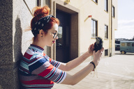 Young female hipster taking selfie while standing against wall - MASF02003