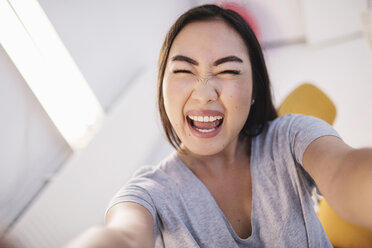 Portrait of cheerful female blogger in office - MASF02219