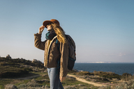 Italy, Sardinia, woman on a hiking trip - KKAF00931