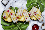 Pina Colada popsicles with candied cherries and pineapple - RTBF01160
