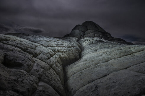 Low angle view of Vermilion Cliffs against cloudy sky - CAVF35558
