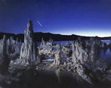 Rock formations in Mono lake against star trails at night - CAVF35651