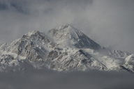 Idyllic view of snowcapped mountains during foggy weather - CAVF35720
