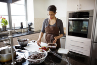 Woman making chocolate truffle at home - CAVF35815
