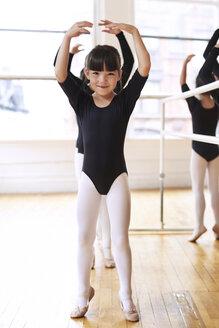 Portrait of cute ballerina performing in studio - CAVF36098
