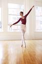 Full length of graceful ballet teacher tiptoeing in studio - CAVF36116