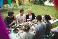 High angle view of friends enjoying dinner at garden party - MASF02387