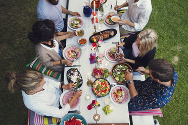 High angle view of multi-ethnic friends enjoying meal at garden party - MASF02393