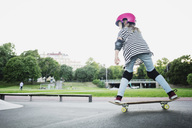 Full length of girl skateboarding at park against clear sky - MASF02459
