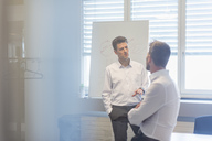 Two businessman having a meeting in office - DIGF03915